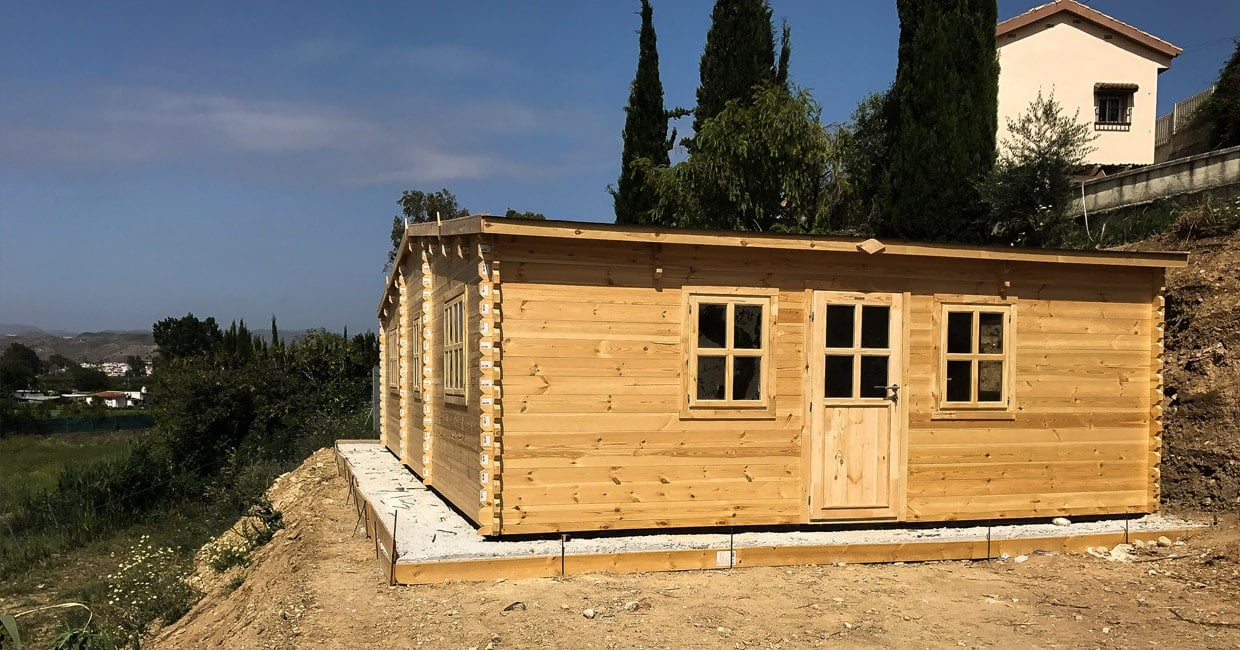 Log cabin homes summer house kits and log garages in for Log home garage kits